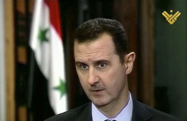 Syrian President Bashar Assad is seen during an interview broadcast on Al-Manar Television.