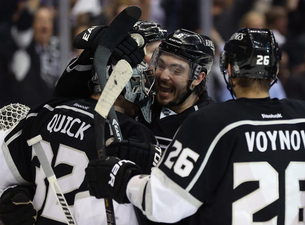 Jonathan Quick, Drew Doughty and Slava Voynov celebrate the 2-1 win over the Sharks in Game 7.