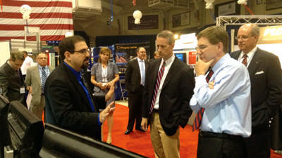 Marios Savvides, director at Carnegie Mellon University's CyLab Biometrics Center, talks with U.S. Rep. Mac Thornberry, R-Texas, and U.S. Rep. Keith Rothfus (right), R-Sewickley at the 23rd annual Showcase for Commerce on Thursday afternoon in Johnstown.