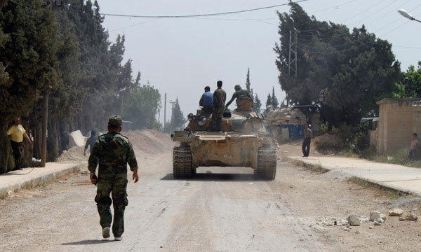 Forces of Syrian President Bashar al-Assad are seen in Arjoun village near Qusair town May 30, 2013.