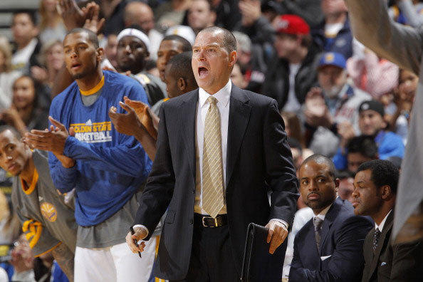 Assistant Coach Mike Malone of the Golden State Warriors yells instructions to his team during a game against the Utah Jazz on January 7, 2012 at Oracle Arena in Oakland, California.