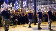 ATHENS -- Greece's government grappled with deepening disarray Friday as coalition partners clashed over an anti-racism bill intended to rein in the rise of Golden Dawn, a far-right party represented in parliament but blamed for violent attacks on migrants and which critics say has neo-Nazi sympathies.