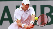 PARIS -- American marathon man John Isner soothed the memory of his record-breaking loss at last year's French Open with victory over Ryan Harrison in another five-set epic on Friday.
