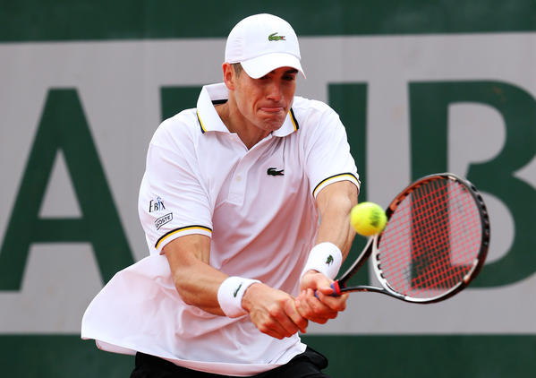 John Isner plays a backhand during his match against Ryan Harrison Friday.