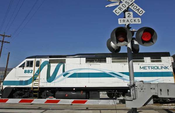 A Metrolink train crosses Grandview Ave. in Glendale last year just north of where Rep. Adam Schiff held his news conference on Thursday.
