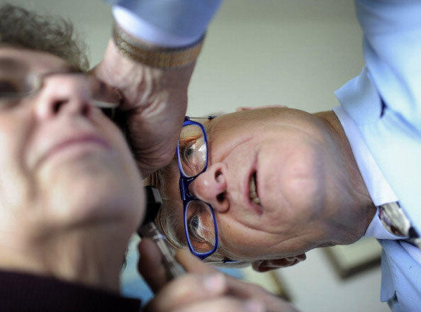 Rural Doctor Emory Lewis, examines an elderly patient who is suffering from headaches, during an examine at his family practice clinic in Reedville, Virginia, Monday, December 12, 2011. Approximately 65 percent of Dr. Lewis' patients are insured by Medicare.