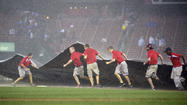 ST. LOUIS -- As the rain fell in sheets and the Busch Stadium field essentially became a sponge, the Kansas City Royals could only sit and fret that their eight-game losing streak might stretch to nine on an obscure technicality.