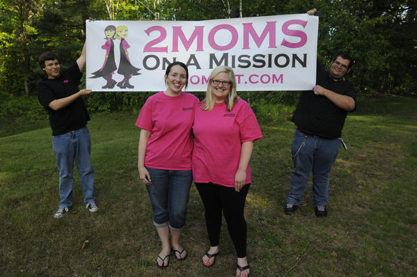 "Lauren Andrews, left, and Kari Monteforte, the ""Two Moms on a Mission."" They are backed up by Stuart Combs, left, and Jesse Bessette, right."