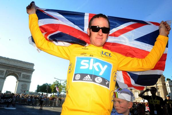 Bradley Wiggins, shown celebrating his 2012 Tour de France victory, has withdrawn from this year's event because of a knee injury.