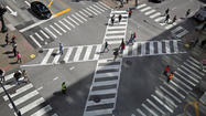 People began walking diagonally through a busy downtown Chicago intersection today, part of an experiment to provide extra breathing room between vehicles and pedestrians.