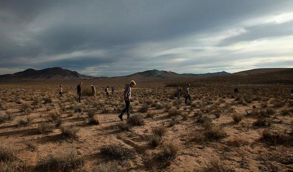 Tourists scour the Mojave desert landscape on the lookout for debris from a 1967 X-15 crash site near Johannesburg March 2 2013.