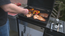 More people are grilling with gas these days. <em>Consumer Reports</em> tested more than 100 gas grills costing from less than $200 to more than $2,000. Some grills do more than the basics, including one with a rotisserie that also has a side burner, perfect for keeping a pot boiling.