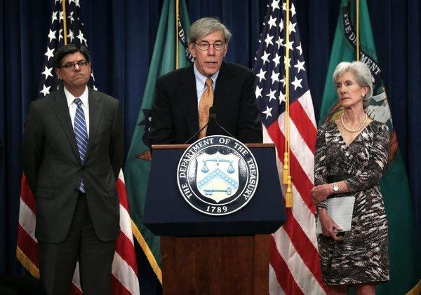 Social Security public trustee Robert Reischauer at Friday's news conference, flanked by Treasury Secretary Jacob Lew and Health and Human Services Secretary Kathleen Sebelius.
