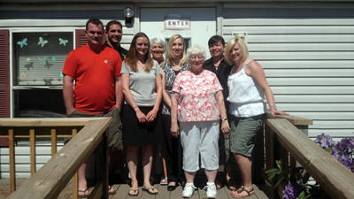 The Family Center staff at their Salisbury headquarters are: Charles Sandy, home visitor; Travis Hutzell, director; Kate Shaffer, home visitor; Jacquie Brenneman-Warne, home visitor; Amber Hutzell, administrative assistant; Carol Davis, office aide; Nohemi Beitzel, home visitor; and Shannon Kosic, home visitor.