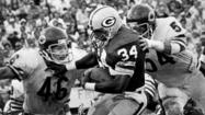 Former Chicago Bears defensive back Doug Plank, 46, and teammate Tom Hicks move on for a tackle against the Green Bay Packers' Terdell Middleton in a game in 1980 at Lambeau Field. (Bill Smith, Getty Images)