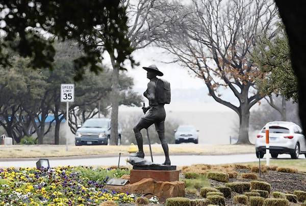 The statue of a scout stands in the entrance to Boy Scouts of America Museum and Family Center in Irving, Texas.