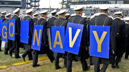 Navy is investigating three members of its football program who are accused of sexually assaulting a female student, military.com reported Thursday.