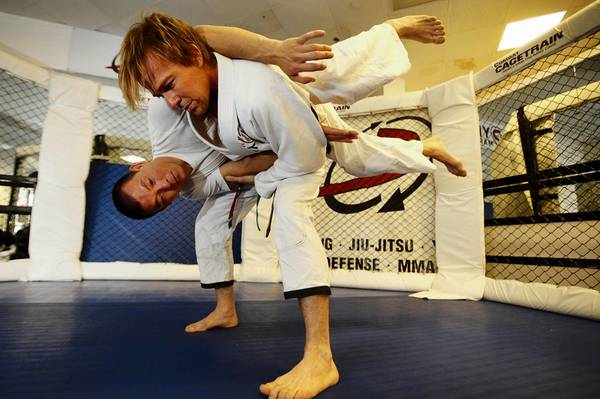 Actor Sean Patrick Flanery, standing, practices jiujitsu with Henry Akins at his gym, Dynamix.