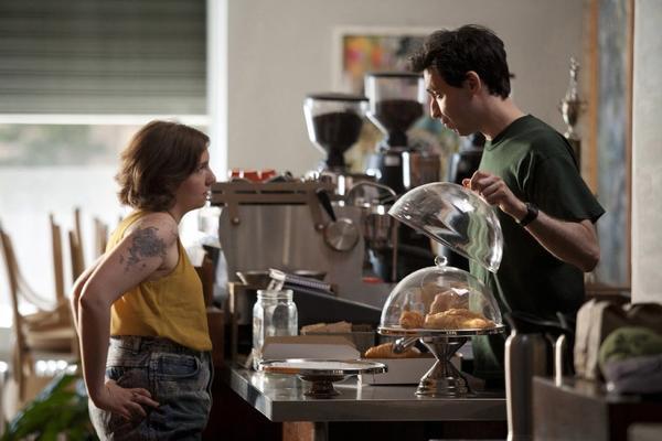 "Alex Karpovsky and Lena Dunham in ""Girls."" Dunham says Karpovsky will be sticking around."