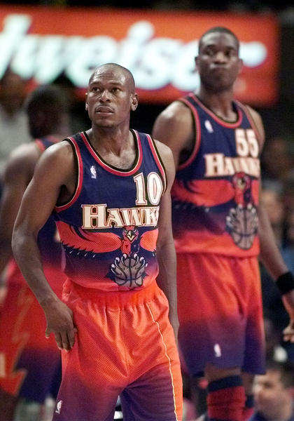 Hawks guard Mookie Blaylock with Dikembe Mutombo during a game in 1999.