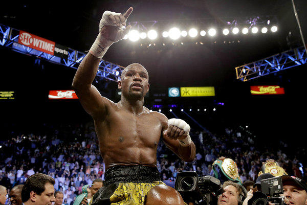 Floyd Mayweather Jr. reacts after defeating Robert Guerrero by unanimous decision in a WBC welterweight title fight.