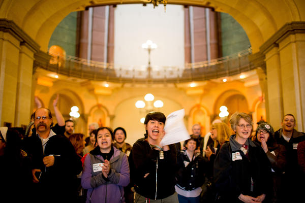 Jennifer Carrillo, center, stands outside the Governor's office with other members of Illinois People's Action while they wait to find out whether a member of the governor's staff will talk to the group about the HB2615 bill Monday, March 4 in the Illinois State Capitol in Springfield.
