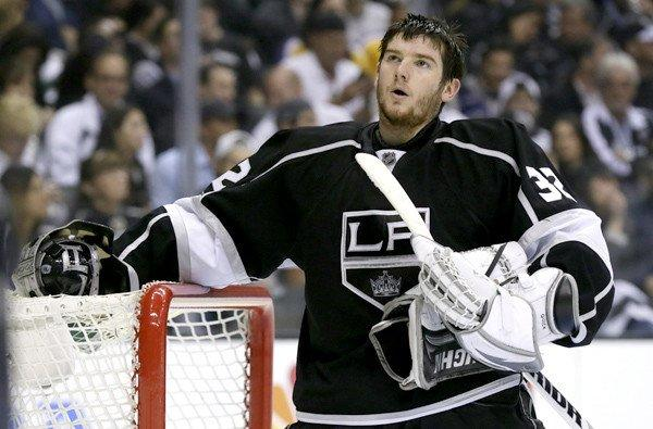 Kings goalie Jonathan Quick catches his breath during a break in the second period of Game 7 against the Sharks.