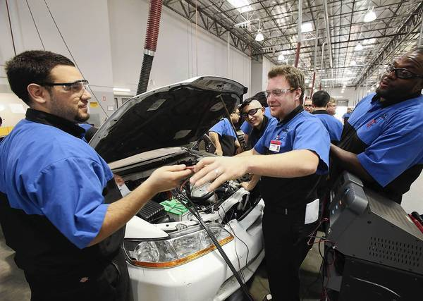 Students run diagnostic tests on a car at WyoTech, operated by Corinthian Colleges, in Long Beach.