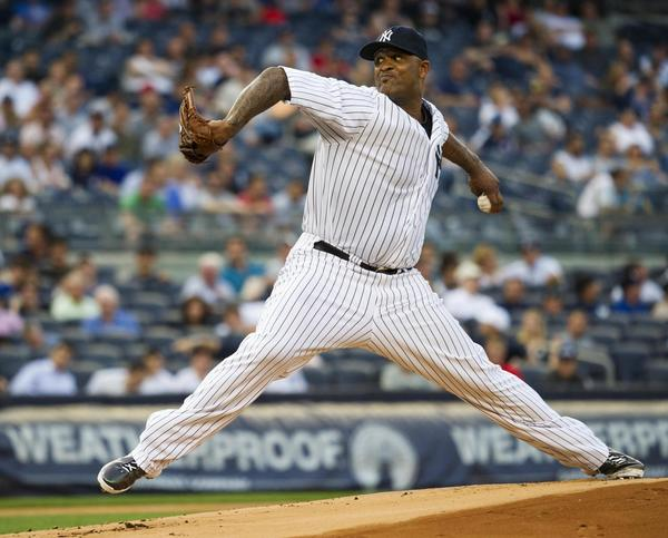 Yankees starter CC Sabathia throws a pitch to the Boston Red Sox in the first inning Friday at Yankee Stadium.