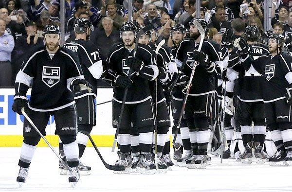 Kings players congratulate each other after beating the San Jose Sharks in Game 7 of their playoff series.