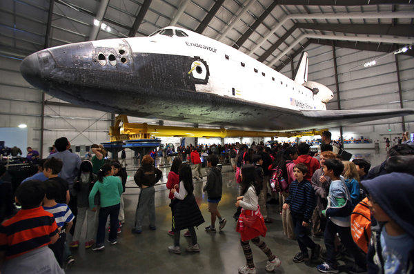 Visitors fill the Samuel Oschin Pavilion to view the space shuttle Endeavour at the California Science Center. As of March, more than 1 million people have visited the museum since the shuttle exhibit was opened.