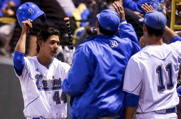 Brett Urabe (44) celebrates with UCLA teammates after scoring a run in the seventh inning against San Diego State on Friday night at Jackie Robinson Stadium.