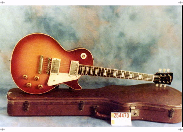 "A Gibson 1960 Les Paul guitar is shown. Gibson Guitars, which had been charged with violating the Lacey Act over wood imported from India and Magadascar (the charges were dropped last year when the company agreed to pay a $300,000 fine) tweeted on Friday: ""Whew! Finally! Report to Congress gives OK to traveling with guitars."""
