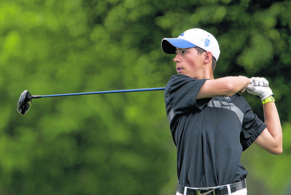 Marian's Michael Makris watches his tee shot fly during Friday boys golf sectional at Erskine Golf Course.