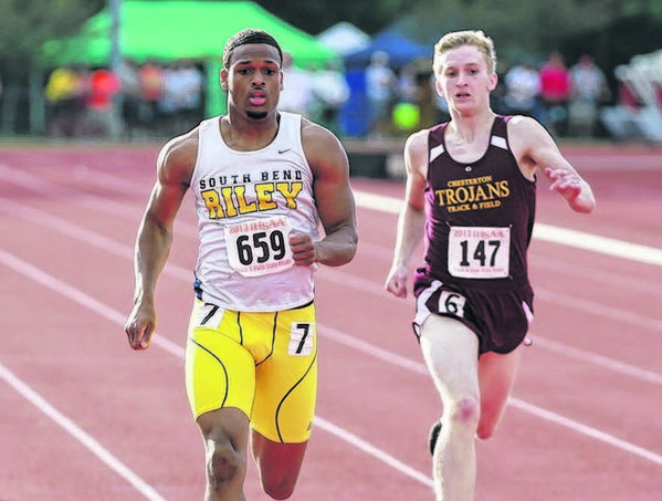 Thomas Capers of Riley, left, races to a second-place finish in the 400-meter race at the state track finals Friday night.