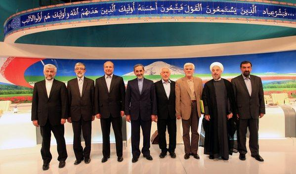 Eight Iranian presidential candidates, from left, Saeed Jalili, Gholam Ali Haddad Adel, Mohammad Bagher Qalibaf, Ali Akbar Velayati, Mohammad Gharazi, Mohammad Reza Aref, Hasan Rowhani and Mohsen Rezaei, pose for a group picture after their television debate in Tehran on Friday.
