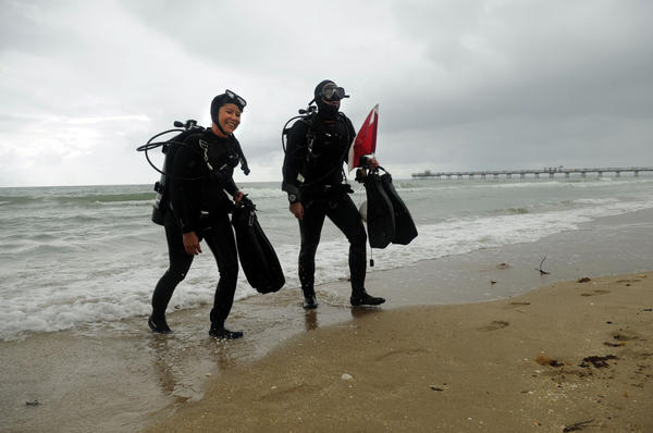 Laurence and Brent Hanks of Boca Raton emerge from the ocean in Lauderdale-by-the-Sea Saturday morning after diving as part of the American Cancer Society's 2013 Air and Sea Relay for Life.