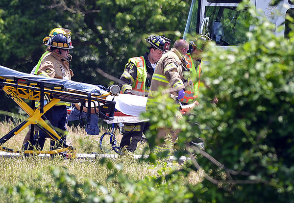 Rescuers move a stretcher to a waiting helicopter Saturday on Interstate 81 north of Williamsport. Multiple vehicles were involved and traffic was held in both directions to allow emergency vehicle access.