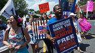 Protesters gather at Fort Meade in support of Bradley Manning
