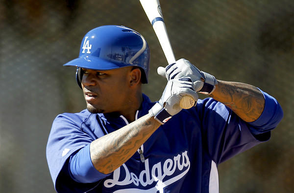 Dodgers left fielder Carl Crawford works on his swing during spring training.