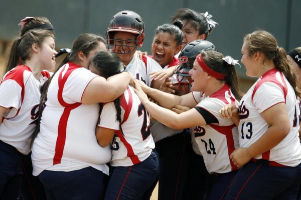 The Bellarmine-Jefferson softball team rejoices after Monique Ladini hits a home run in the CIF Division VI championship game against Mary Star.