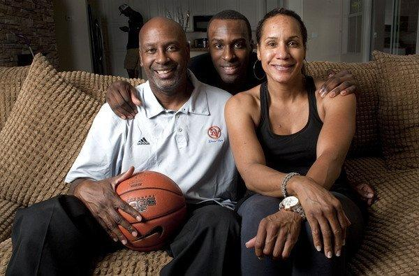 Former UCLA basketball star Shabazz Muhammad, center, poses for a photo with his parents, Ron and Faye, in Las Vegas.