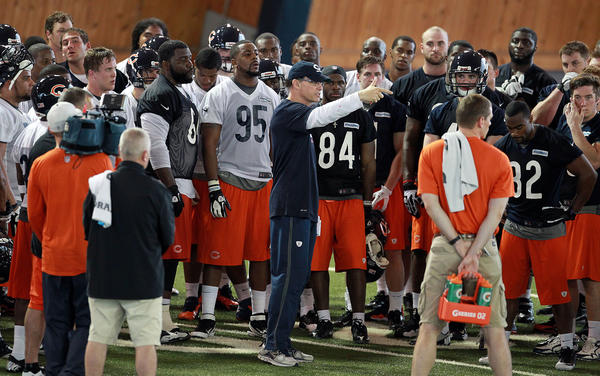 Bears coach Marc Trestman talks to his team at the end of practice on the first day of rookie minicamp.