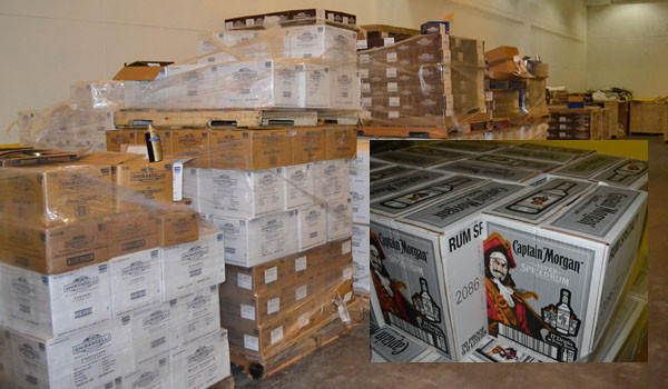 Among stolen items found at a Southwest Side warehouse were 52 cases of chocolate and numerous cases of alcohol (inset).