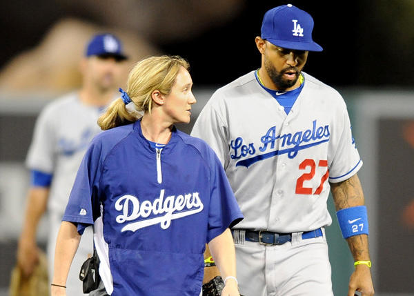 Dodgers' Matt Kemp comes out of the game with Dodgers assistant trainer Nancy Patterson in the seventh inning against the Angels.