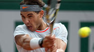 Rafael Nadal slips past Fabio Fognini to advance in French Open