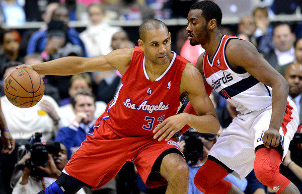 Clippers forward Grant Hill, working against Washington Wizards point guard John Wall during a game last season, announced his retirement after playing 18 NBA seasons.