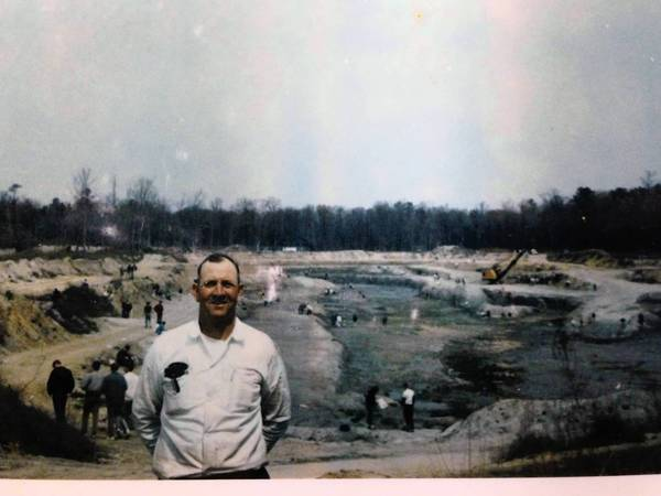 William Macon Rice stands in front of his bustling borrow and fossil pit off Hampton's Harris Creek Road in this mid-1960s photo.