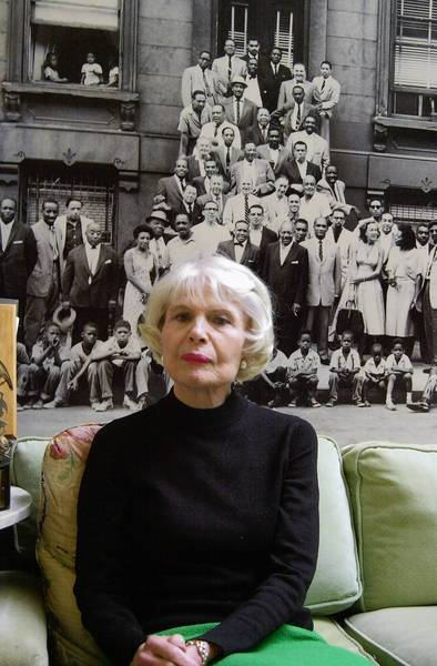 "Documentary filmmaker Jean Bach in 2003. Bach co-wrote and directed ""A Great Day in Harlem,"" which was nominated for an Academy Award. The 1994 film chronicles how art director Art Kane coordinated a group photograph (hanging behind her) of top jazz musicians in New York City in 1958."