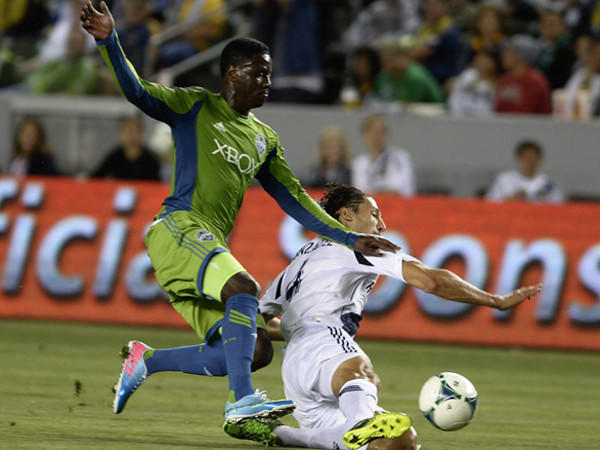 Galaxy's Omar Gonzalez, right, takes on Seattle's Eddie Johnson last week in a game in which the Galaxy matched its season high for goals (4).